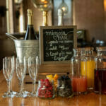 mimosa bar with champagne and fruit for private event at The Mill in Hershey
